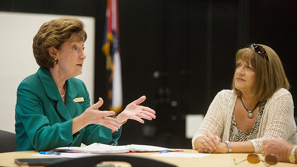 Globe/Roger Nomer<br /> Brenda Dietrich, of Ray and Associates, talks with Sheila Damer, Joplin, about the superintendent search during a forum on Wednesday at Joplin High School.