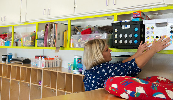 Globe/Roger Nomer<br /> Melissa Talbott sets up her classroom on Monday at the Joplin Early Childhood Development Center.