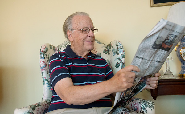 Globe/Roger Nomer<br /> Larry Sanborn reads his copy of the Joplin Globe on Monday morning.