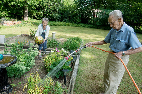 Globe/Roger Nomer<br /> Crystal and Neal Ruff work in their garden on Tuesday.
