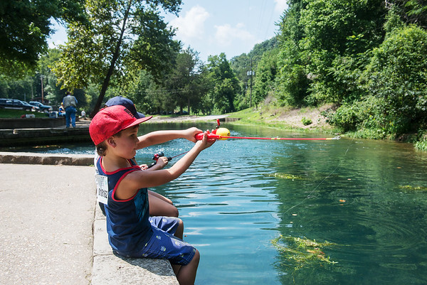 Globe/Roger Nomer<br /> Jackson Weathers, 5, Shawnee, Kan., fishes with his sister Isabella, 7, on Thursday at Roaring River State Park.