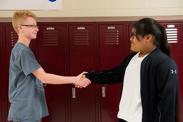 Globe Photo Illustration/Roger Nomer<br /> South Middle School eighth graders Levi Stokesbary and Karihn Handy demonstrate proper handshake technique.