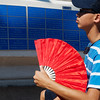 Globe/Roger Nomer<br /> John Pham, 13, Lincoln, Neb., stays cool while waiting for friends on Thursday at Marian Days in Carthage.