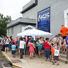 Hundreds of people wait in line for back-to-school shoes at Oasis Church of Joplin on Saturday afternoon. The church was giving away 500 free pairs of shoes on a first-come, first-served basis on Saturday. <br /> Globe | Laurie Sisk