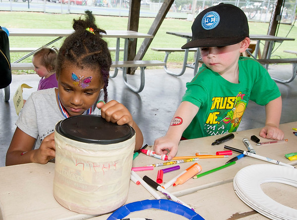 From the left: Niyah Cline, 5 and Finn McFadden, 3, decorate their own drums inside Kids Fest on Saturday at Ewert Park during the second day of Emancipation Days.<br /> Globe | Laurie Sisk