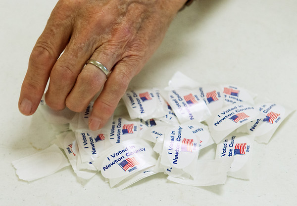 Globe/Roger Nomer<br /> Stickers are prepared for voters during Tuesday's primary at the Redings Mill Fire Department.