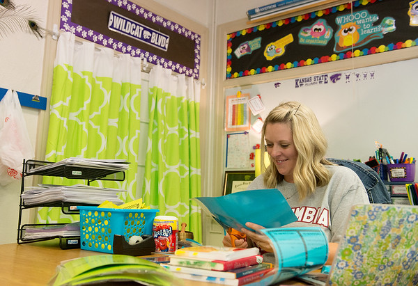Globe/Roger Nomer<br /> Janel Harding preps her fourth-grade classroom on Tuesday at Columbia Elementary.