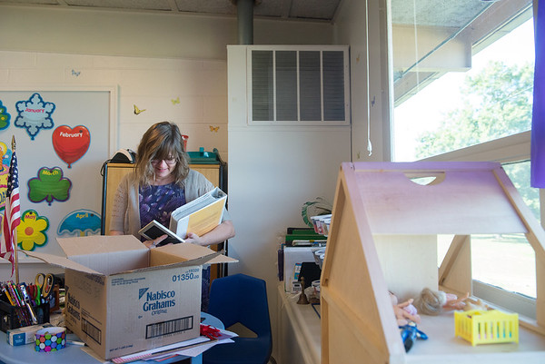 Globe/Roger Nomer<br /> Sonya Anderson unpacks her classroom on Monday at the Joplin Early Childhood Center.