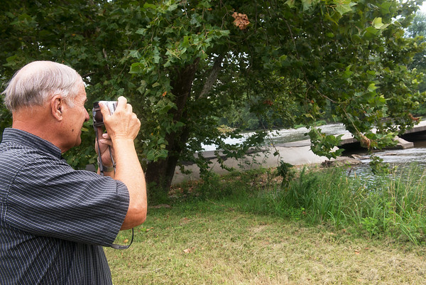 Globe/Roger Nomer<br /> Rod Harsh takes a photo of the low-water bridge at Jackson on Friday.