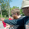 Globe/Roger Nomer<br /> Deon Anderson, right, a member of the East Town mural design team, talks with mural artist Kyle McKenzie on Wednesday.