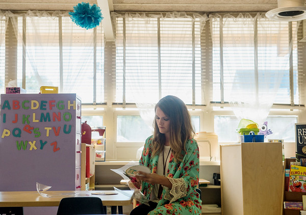Globe/Roger Nomer<br /> Baily Austin prepares her classroom at the Early Childhood Center on Monday. After previous school years in trailers, teachers at the center are excited for the windows giving their classrooms natural light.