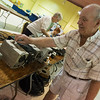 Globe/Roger Nomer<br /> Jim Bennett, Bella Vista, cleans up World War II command sets on Friday in preparation for the Joplin Amateur Radio Club 2016 Hamfest at the Joplin Trade Center. The Hamfest runs from 8 am to 2 pm today, and will include vendors, testing and forums on amateur radio.