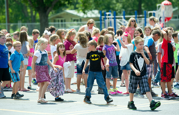 Third graders return to their classrooms after recess on the first day of school on Thursday at Seneca Elementary.<br /> Globe | Laurie Sisk