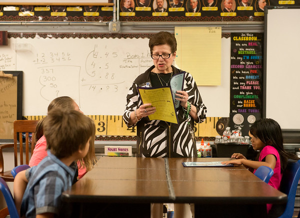 Globe/Roger Nomer<br /> Mark Twain Elementary Principal Laurel Rosenthal quizzes students on their spelling lesson on Monday.