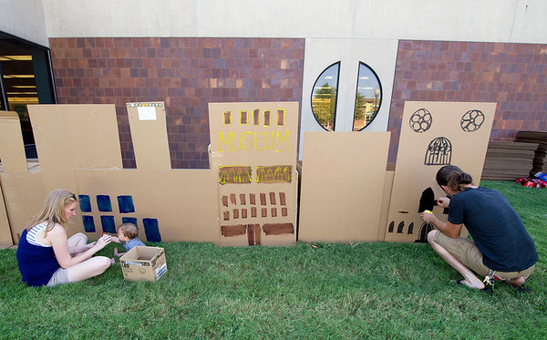 From the left: Tara Clark, Moses Youngblood, 9 months, and Wayne Kmick help decorate a cardboard city during the First Thursday Artwalk on Thursday evening at the Joplin Public Library. The event was sponsored by the Spiva Center for the Arts.<br /> Globe | Laurie Sisk