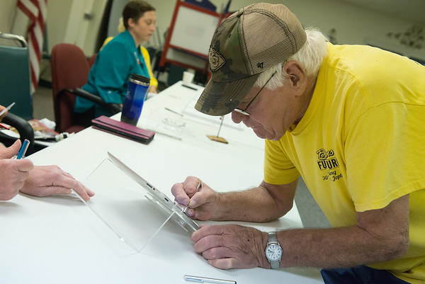 Globe/Roger Nomer<br /> Robert Bucklin signs in to vote in Tuesday's primary at the Joplin Association for the Blind.