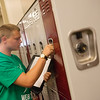 Globe/Roger Nomer<br /> Christopher Anderson, eighth grade, opens his locker on Thursday on the first day of class at East Middle School.