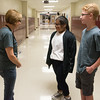 Globe Photo Illustration/Roger Nomer<br /> South Middle School eighth graders Karihn Handy and Levi Stokesbary demonstrate proper communication technique with teacher Judith Hartman.