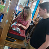 Globe/Roger Nomer<br /> Denise Stafford works with Sweelye Xiong, junior, and Eric Putman, senior, at the school store in East Newton High School on Tuesday.