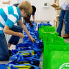 Globe/Roger Nomer<br /> Marshall Stamford, 12, helps assemble gift bags on Tuesday for police officers and their spouses at St. John's Lutheran Church in Pittsburg.