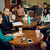 Globe/Roger Nomer<br /> Brenda Dietrich and Ryan Ray talk with Joplin High students about the district's next superintendent during a forum on Wednesday at Joplin Avenue Coffee.