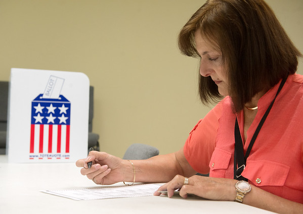 Globe/Roger Nomer<br /> Heidi DeRocili votes during Tuesday's primary at the Redings Mill Fire Department.