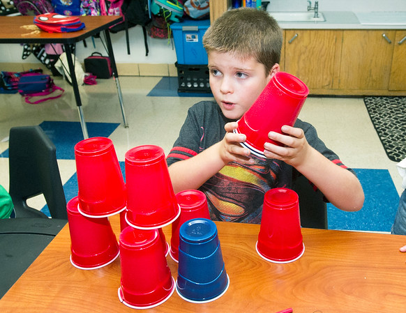 Seneca Elementary third grader Aedric Batson, 8, listens to instructions for a team-building exercise in Heather Lankford and Gwyn Osborne's class on Thursday during the first day of school for Seneca students.<br /> Globe | Laurie Sisk