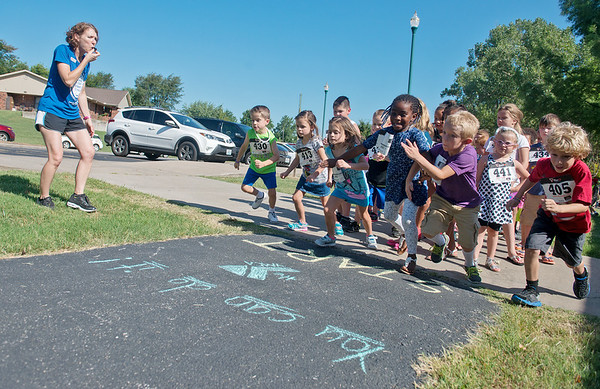 Globe/Roger Nomer<br /> Running Coach Karen King starts off race for the annual Kids Run the Nation Fun Run on Thursday at Leonard Park. After training for 6 weeks, over 100 Joplin Family YMCA day campers ran in the event. The run was funded in part by Active Lifestyles Events of Joplin.