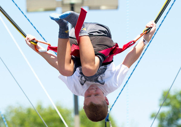 Six-year-old Bo Hogue completes a backflip on the Euro Bungee during Vacation Bible School on Thursday at First United Methodist Church.<br /> Globe | Laurie Sisk