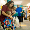 Globe/Roger Nomer<br /> Amanda Parker, holding daughter Everleigh Buchanan, 1, says goodbye to her son Parker Johnson on Thursday on his first day of kindergarten at McKinley Elementary.