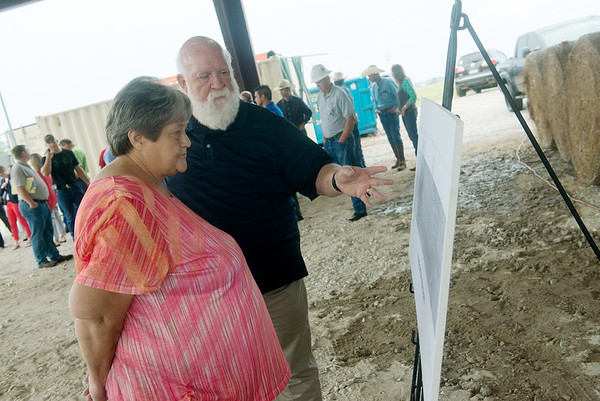 Globe/Roger Nomer<br /> Marilyn Rogers, member of the Quapaw business committee, and Paul Darby, consultant for the Quapaw Tribe, look over plans for the tribe's meat processing plant on Wednesday.