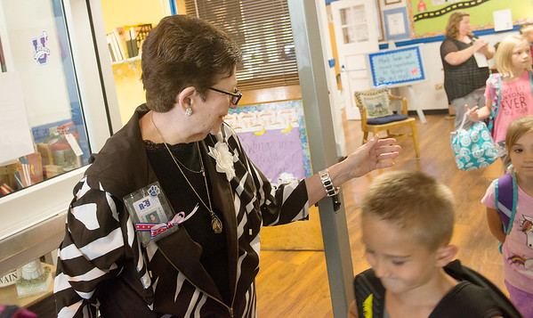 Globe/Roger Nomer<br /> Mark Twain Elementary Principal Laurel Rosenthal says goodbye to students after school on Monday.