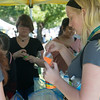 Globe/Roger Nomer<br /> Maria Powell, a Missouri Southern sophomore from Hardin, creates sand art during the Welcome Week Picnic on Monday.