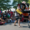 Globe/Roger Nomer<br /> Dominic Mai, Lincoln, Neb., practices a traditional snake dance with a lion head on Thursday at Marian Days in Carthage. Mai was part of one of several dance teams meeting at Marian Days to exchange ideas and emphasize tradition.