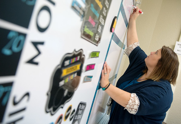 Globe/Roger Nomer<br /> Cyndi Conway preps her classroom on Tuesday at North Middle School.