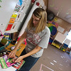 Globe/Roger Nomer<br /> Kerri Rea sets up her kindergarten classroom on Tuesday at Columbia Elementary.