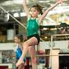 Ten-year-old Kenley Taylor perfects her skills on the balance beam during classes on Wednesday night at The Flip Shop.<br /> Globe | Laurie Sisk