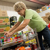 Globe/Roger Nomer<br /> Debbie Hobart volunteers with fellow Empire employees on Monday at Crosslines as they sort donations from JOMO Restaurant Week.