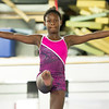 Eleven-year-old Aniya Clark practices on the balance beam during classes on Wednesday night at The Flip Shop.<br /> Globe | Laurie Sisk