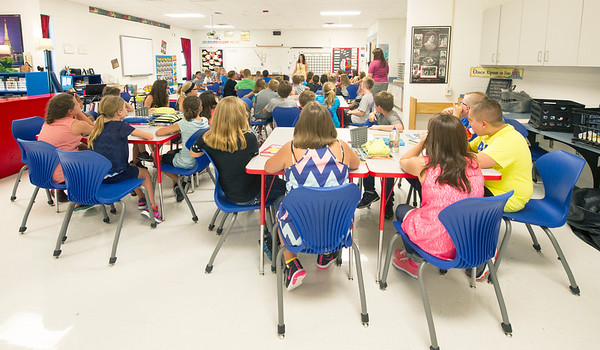 A combined classroom of 48 students listens to their teachers on the first day of school on Thursday at Seneca Elementary.<br /> Globe | LAurie Sisk
