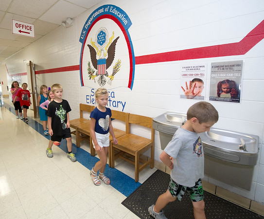 Students pass through the hallway on the first day of school on Thursday at Seneca Elementary.<br /> Globe | Laurie Sisk