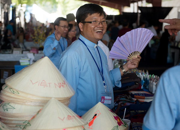 Globe/Roger Nomer<br /> Fx. Nguyen Minh Thieu, Vietnam, talks with visitors on Thursday at Marian Days in Carthage.