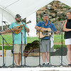 Members of the Central City Grass Band, from Central City, Ark., entertain hundreds at the 3rd Annual Big Spring Bluegrass and BBQ on Saturday at Neosho's Big Spring Park. Ten bands and numerous vendors displayed their musical and culinary talents at the event.<br /> Globe | Laurie Sisk