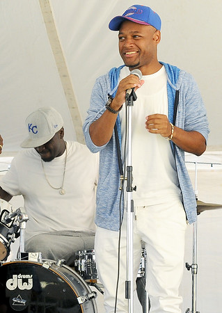 Comedian Carrington Lopez shares a laugh with Mind, Body and Soul drummer D.L. Marshall on Friday at the annual Emancipation Park Days at Ewert Park.<br /> Globe | Laurie Sisk