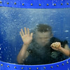 Joplin Explorer Boston Ballard, 16, waves from the bottom of a dunk tank during the National Night Out on Tuesday night at Schifferdecker Park. The annual national event encourages the building of relationships between emergency personnel and the communities they serve.<br /> Globe | Laurie Sisk