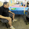 Five-year-old Alfredo Simpson smiles as he shoots a cup off the head of Pastor Greg Esselman during the Back-to-School Carnival on Saturday at First Presbyterian Church in Carthage. The event featured children's games, refreshments and more.<br /> Globe   Laurie Sisk