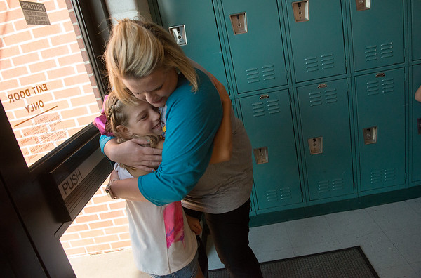 Globe/Roger Nomer<br /> Goodman Elementary Principal Samantha Hamilton gives a welcome-back hug to Sadee DePriest, fourth grade, during Monday's open house.
