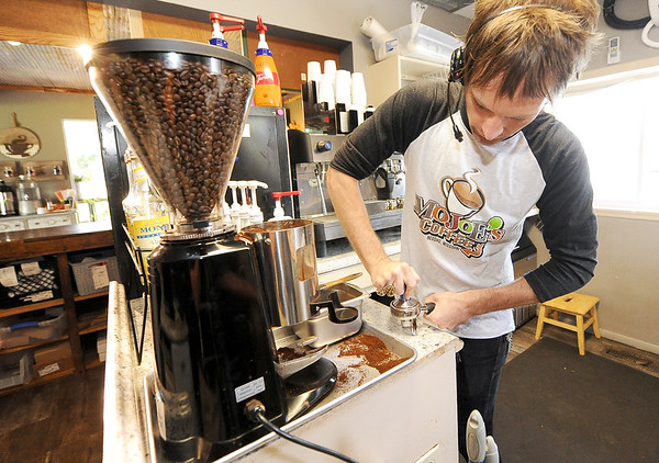 Barista Joey Wagner grinds fresh coffee beans on Saturday at Mo Joe's Coffee in Neosho. The City of Neosho has seen a dramatic increase in sales tax revenues lately.<br /> Globe | Laurie SIsk