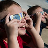 Globe/Roger Nomer<br /> Brothers Corbin, 7, and Skylar, 6, Crist, Joplin, take in the solar eclipse on Monday at the Joplin Public Library.