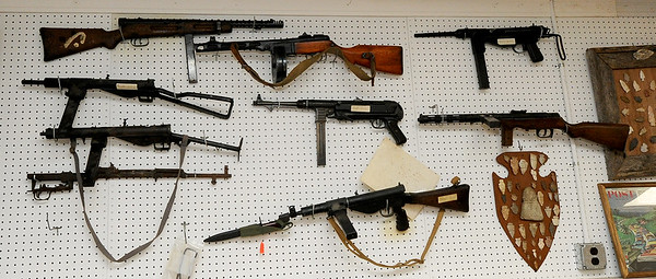 Automatic weapons from countries such as Russia, Italy, Portugal, England, Germany and more hang on a wall at Circle T Collectibles in Carl Junction. The weapons have been demilled (rendered inactive) per federal law.<br /> Globe | Laurie Sisk